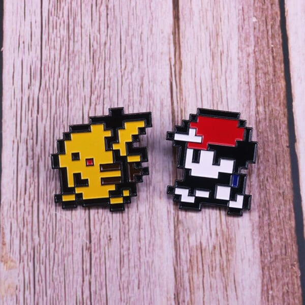 Ash & Pikachu Enamel Pin on wooden surface